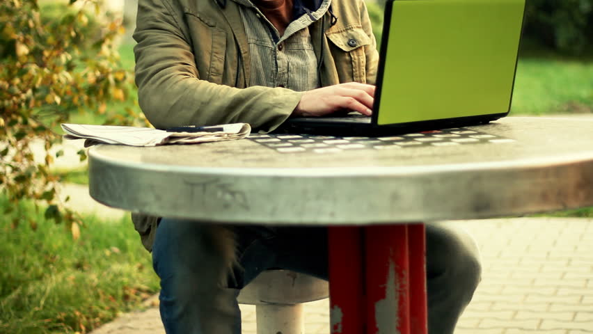 Working on laptop, outdoors  - HD stock footage clip