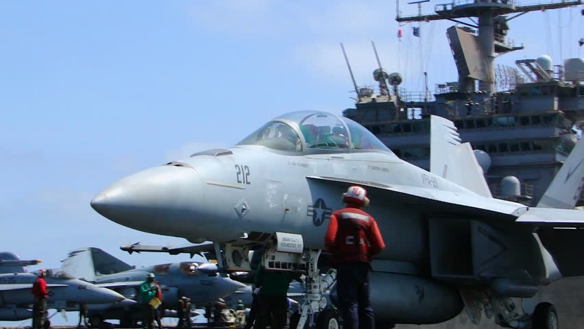 CIRCA 2010s - A fighter jet takes off from an aircraft carrier.