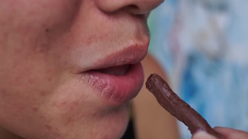 lady eats chocolate stick bread