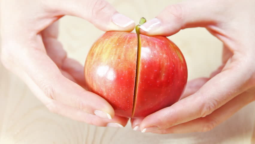 Two halves of an apple. Manicure professionally done.  - HD stock video clip