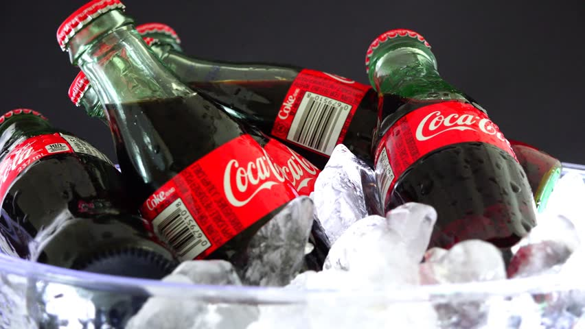 TORONTO,CANADA-MARCH 8,2015: Coca Cola on ice stock footage.Coca-Cola is a carbonated soft drink sold throughout the world. It is produced by The Coca-Cola Company of Atlanta, Georgia.