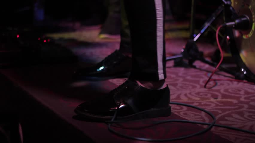 singer's particular shoes during a gig  - HD stock video clip