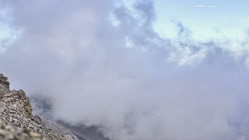 4k, Clouds drifting through volcanic mountain range time lapse, Haleakala, Maui, Hawaii - 4K stock video clip