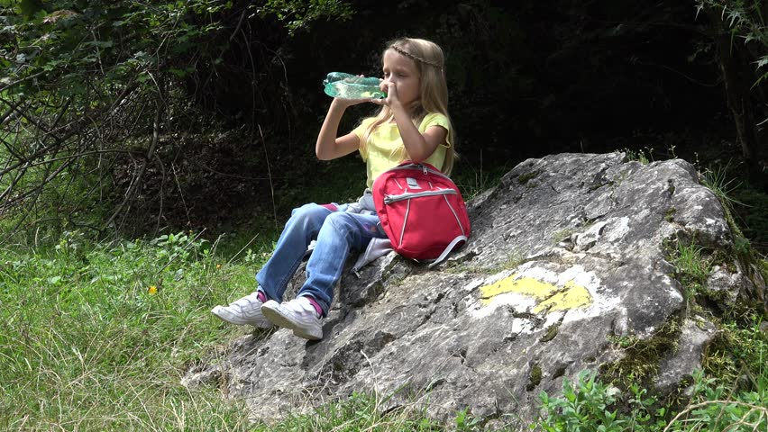 4K Thirsty Little Girl Drinking Water On Mountains Trail ...