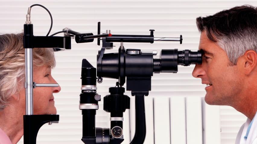 Optician examining a patients eyes in ultra hd format | Shutterstock HD Video #9133463