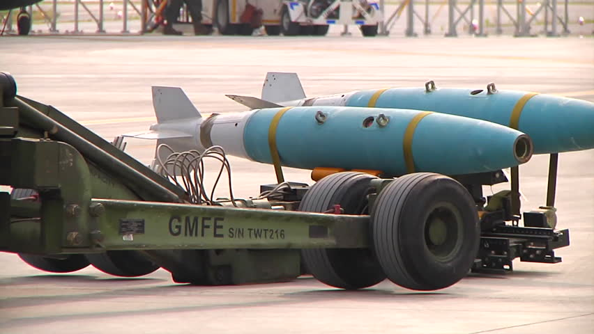 CIRCA 2010s - Bombs are loaded onto a jet aircraft by military personnel. - HD stock footage clip
