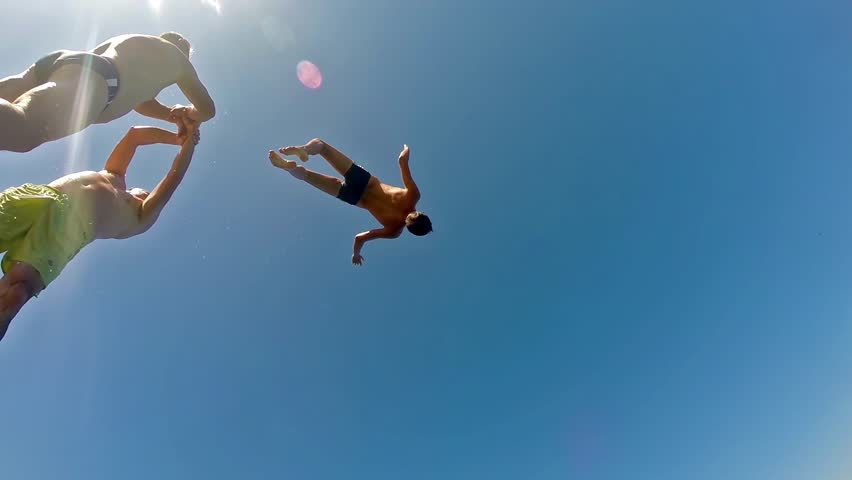 High Water Jumping from Springboard Back flip and diving, Slow Motion