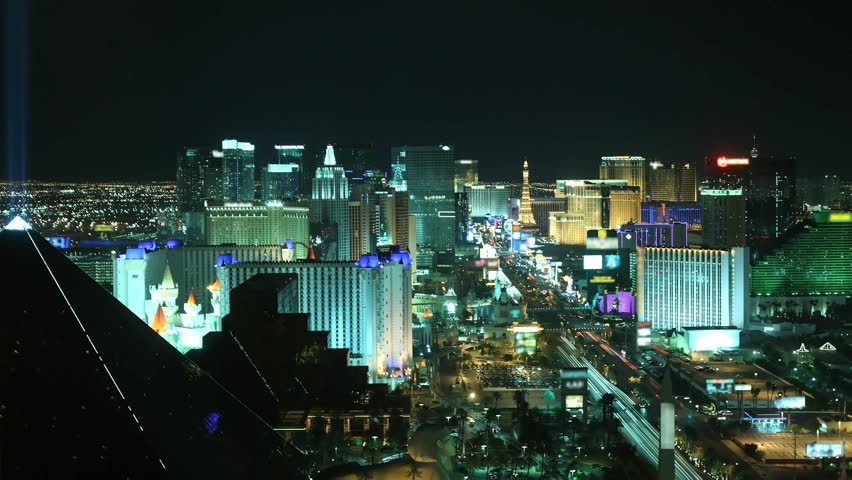 Time lapse Las Vegas at night from high above. All trademarks are blurred.