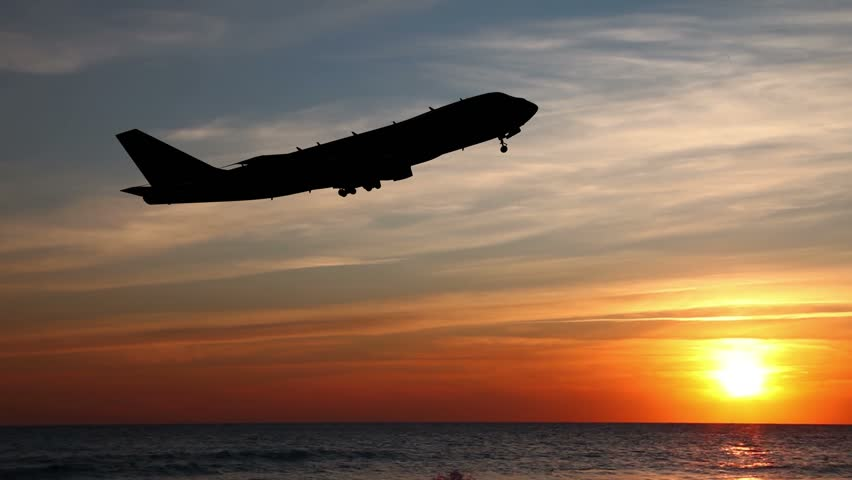 Airplane Take Off Silhouette. Passenger plane flies over the sea at night. | Shutterstock HD Video #9169103