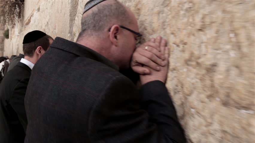 JERUSALEM, ISRAEL - FEBRUARY 08, 2015: Steadicam of believers religious Orthodox Jews pray at the Wailing Wall Jewish shrine in southern part of old city Jerusalem on Feb 08, 2015 in Western wall.