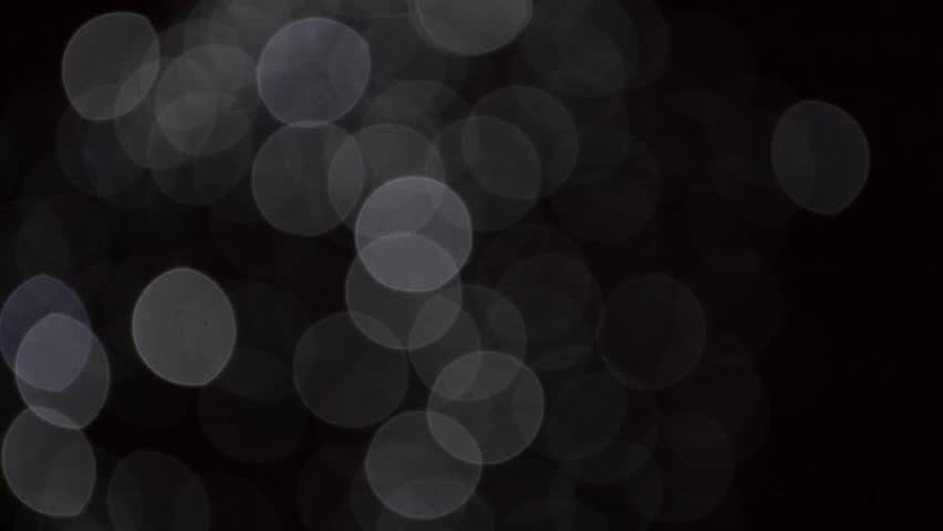 diffuse bright bokeh circles against a dark background - HD stock video clip