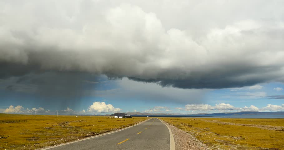 4k huge clouds mass rolling over namtso road,herdsman tent.,Danggula(Tanggula) Mountains in xizang Plateau,herdsman tent,cars traveling on the road,roof of the World. gh2_09230_4k