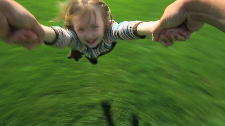Point-of-view shot of a father spinning his young daughter around in their yard  - HD stock footage clip