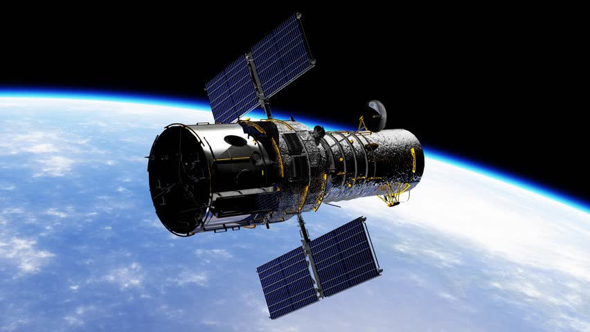 The Hubble Space Telescope is slowly rotating in the orbit of planet earth