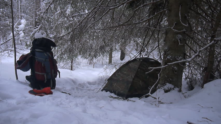 tent is among snowy winter forest
