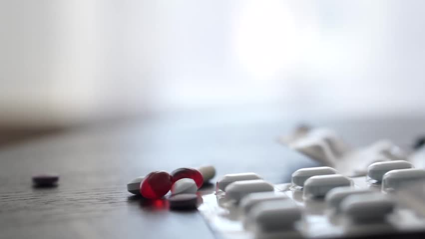 Isolated pills on a table  - HD stock video clip