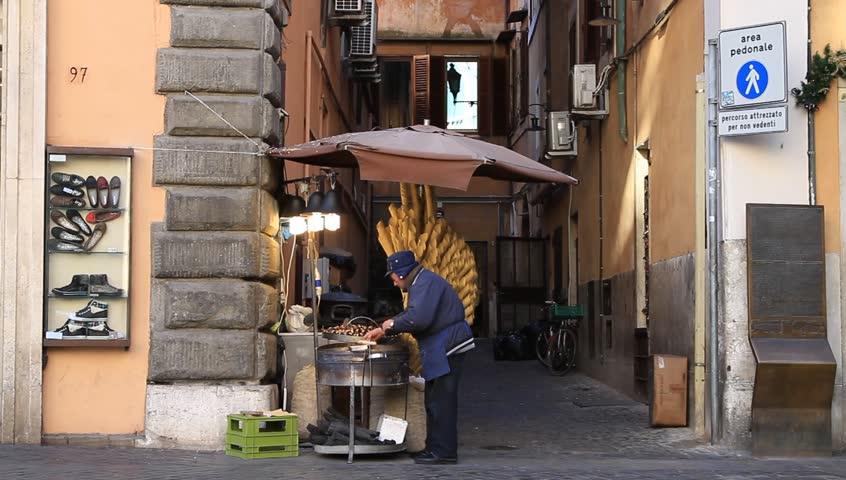 Rome_Jan. 2012:Senior man selling street food near Trevi fountain in Rome, Italy