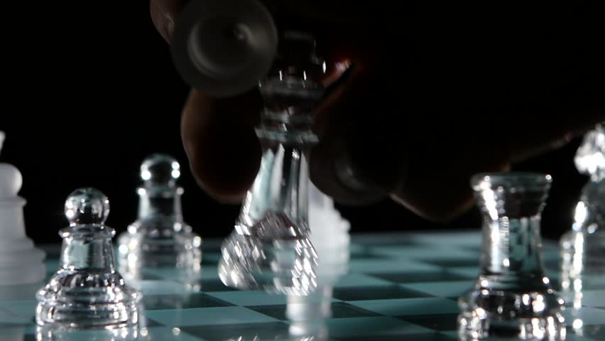 Fight chess pieces on chessboard. Black background.  Slow motion | Shutterstock HD Video #9278588