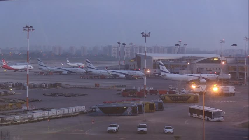 TEL AVIV, ISRAEL - March 15, 2015: Airplanes of Israel of EL AL airlines at  at a loading gates in early morning at Ben Gurion Airport,  March 15, 2015 Tel Aviv Israel.