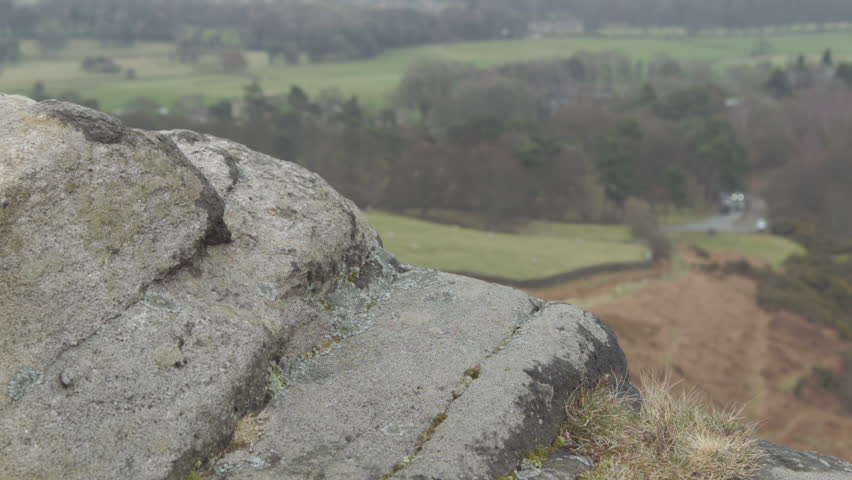 Rock boulder close up HD stock footage. A close up dolly shot of a rock boulder on a Yorkshire moorland filmed on the BMD Cinema Camera. ProRes 422.