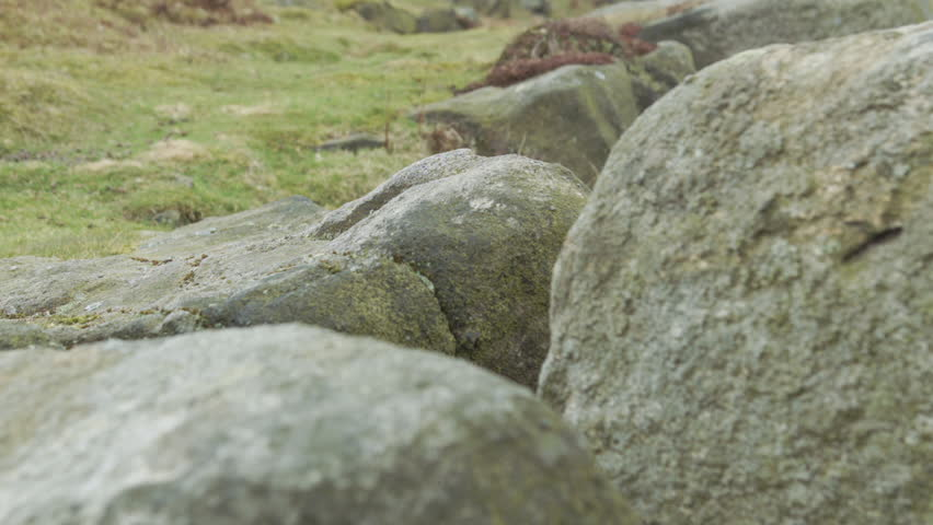 Rock boulders close up HD stock footage. A close up dolly shot of rock boulders on a Yorkshire moorland filmed on the BMD Cinema Camera. ProRes 422.