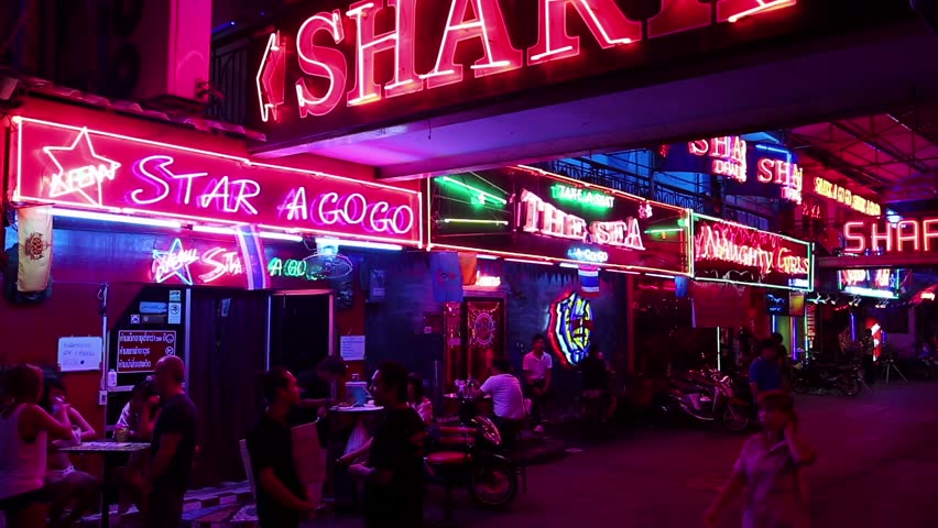THAILAND, PATTAYA, MARCH 31, 2014: Walking Street is red-light district with many restaurants, go-go bars and brothels, that draws people, primarily for night life and sexual entertainments - HD stock footage clip