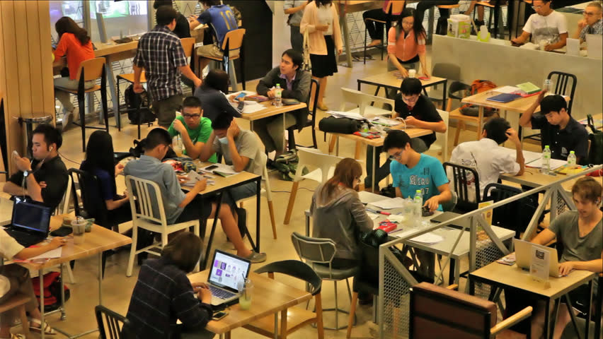 CHIANGMAI, THAILAND - MARCH 14, 2015: Asian students group studying & working together in cafe area