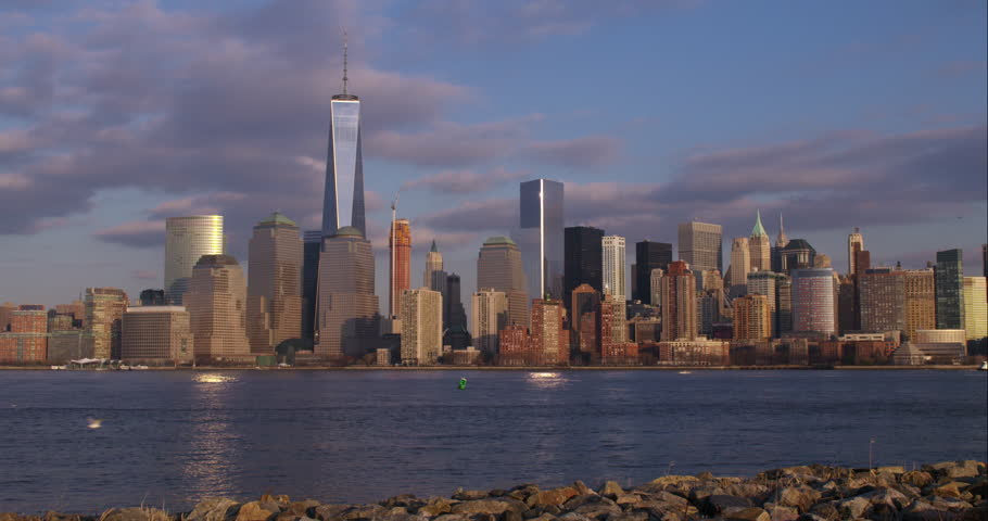The Downtown Manhattan skyline on a clear morning. Ferries go along the Hudson River | Shutterstock HD Video #9325838