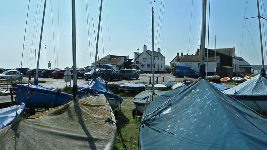 small sailing boats with covers in boat park