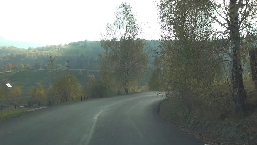 ROMANIA, TRANSYLVANIA, MOECIU, SEPTEMBER 20, 2014: Driving shot with inside camera, on a road,  Traffic view, Mountain holiday. POV. - HD stock footage clip