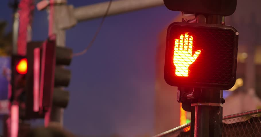 Traffic signal light changes from red to green at night. 4K UHD.
