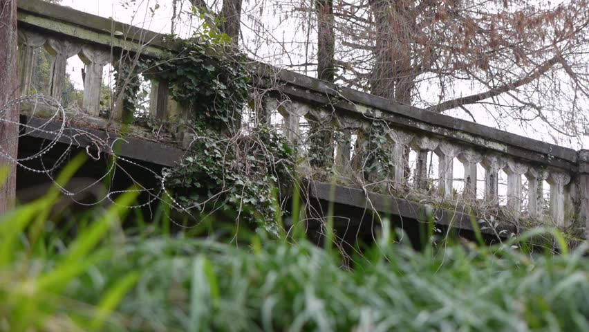 Old Balustrade with Barbed Wire in Botanic Garden - HD stock footage clip