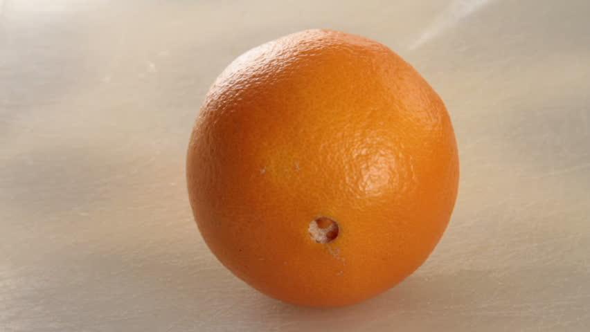 cutting an orange