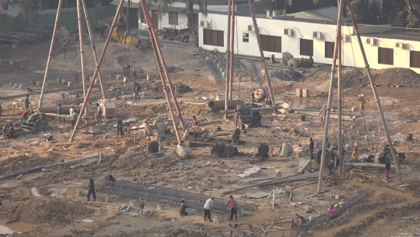 DHAKA, BANGLADESH - 28 DECEMBER 2014: Overview of a construction site in Dhaka. - 4K stock footage clip