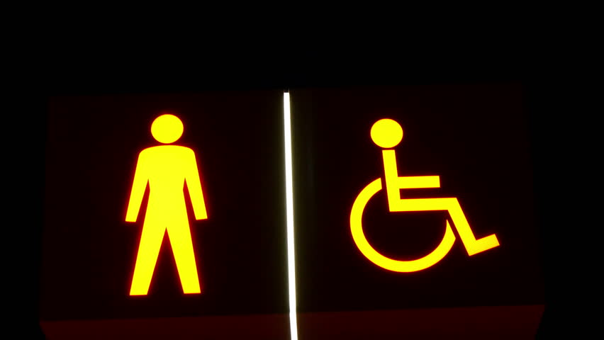An image of a stick man and a symbol of disabled man. These can be seen on the traffic lights or subway   Shutterstock HD Video #9495299
