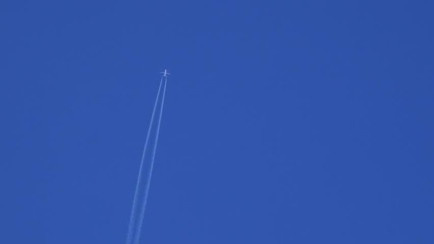 Aircraft Vapor Trails Clear Blue Sky - 4K stock video clip