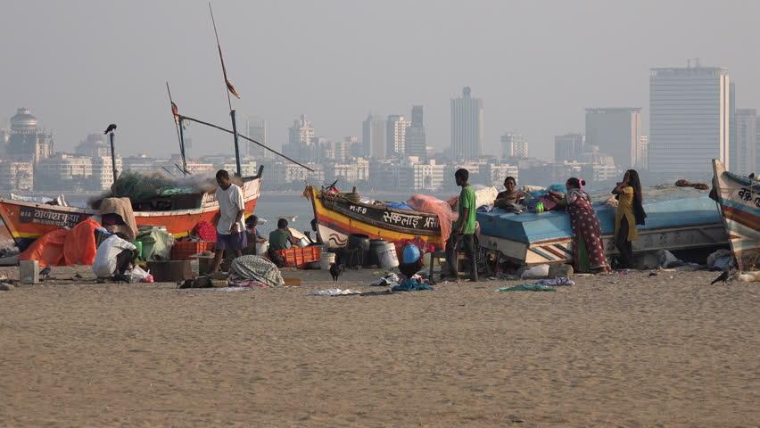 MUMBAI, INDIA - 9 NOVEMBER 2014: Unidentified homeless people live on Chowpatty Beach, some of them are fishermen, in Mumbai.