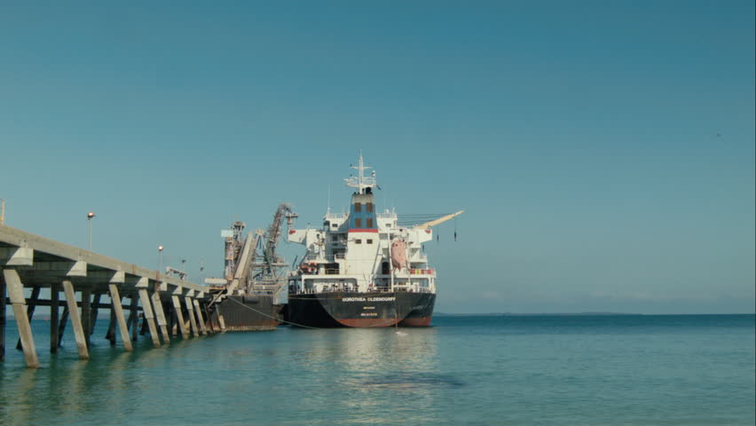 KWINANA, AUSTRALIA - SEPTEMBER 2014: A bulk carrier ship docked at a jetty in Kwinana, in Western Australia, ready for loading. - HD stock footage clip