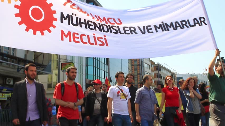 ISTANBUL - MAY 1, 2013: Engineers and architects during protest on labor day. They demand on solution of many social issues such as corruption and unemployment. Engineer and architect march to protest