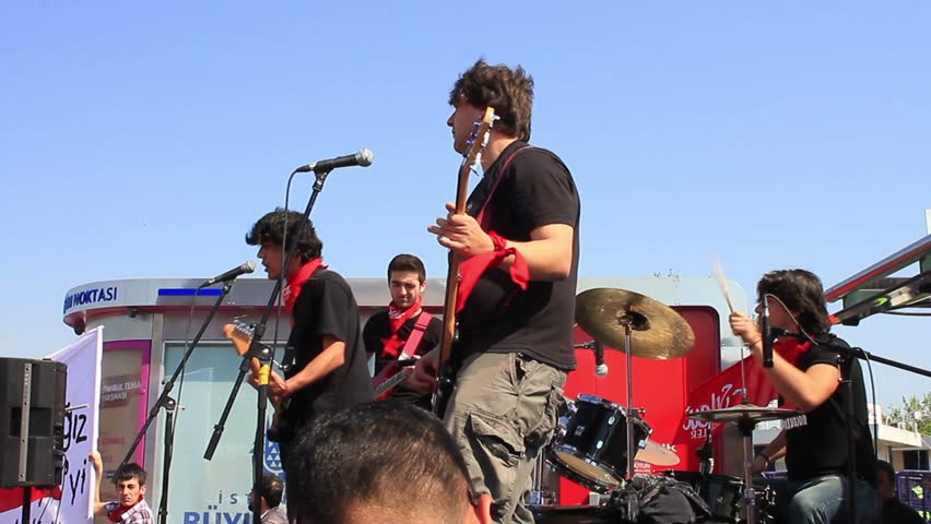 ISTANBUL - MAY 1, 2013: Young men during the protest concert at Kadikoy Pier for labor day. They demand on solution of many social issues, such as corruption and unemployment.