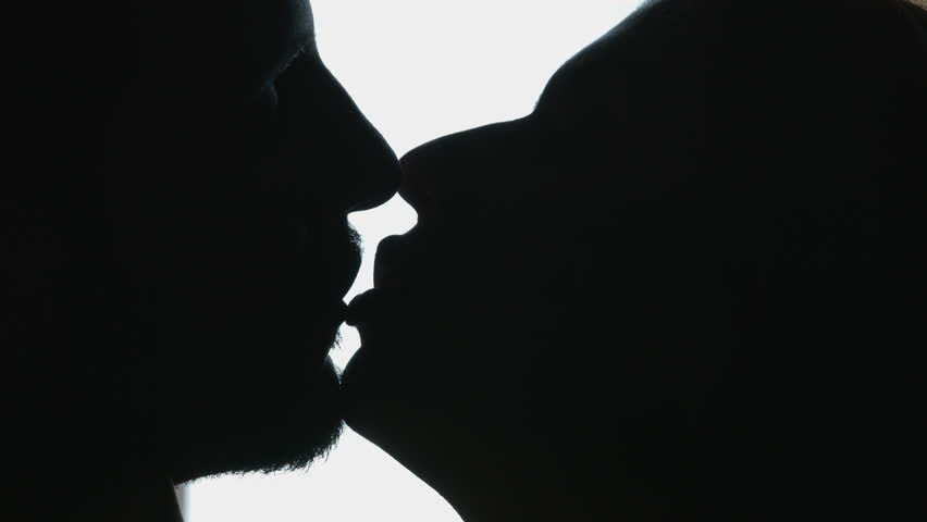 silhouette of couple kissing - 4K stock footage clip