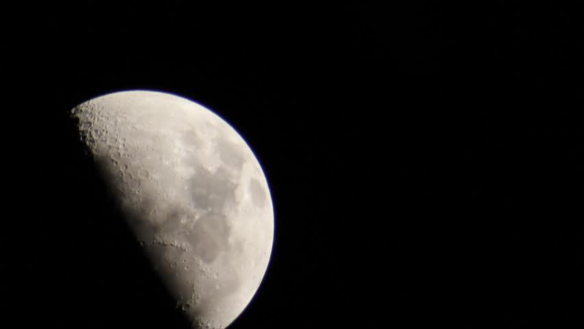 View half moon on clear black sky