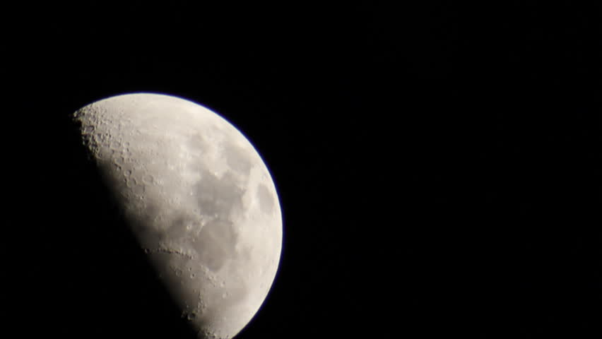 View half moon on clear black sky