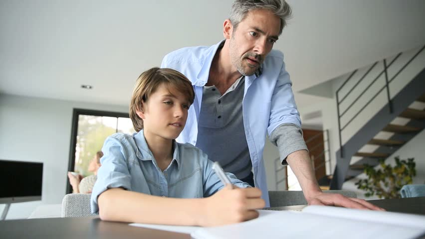 Parents helping kid with homework | Shutterstock HD Video #9607187