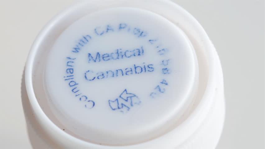 Overhead Close Up Shot of Medical Marijuana in Plastic Prescription Container