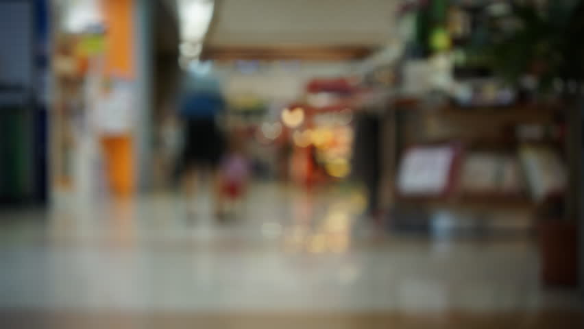 Timelapse movie of blurry people walking at shopping mall