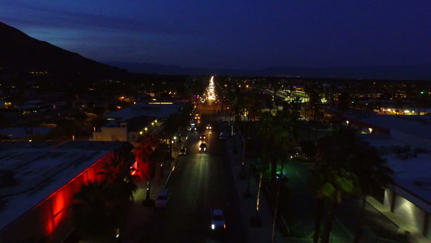 Palm Springs Aerial v3 Flying low over downtown Palm Springs at dusk. - HD stock footage clip