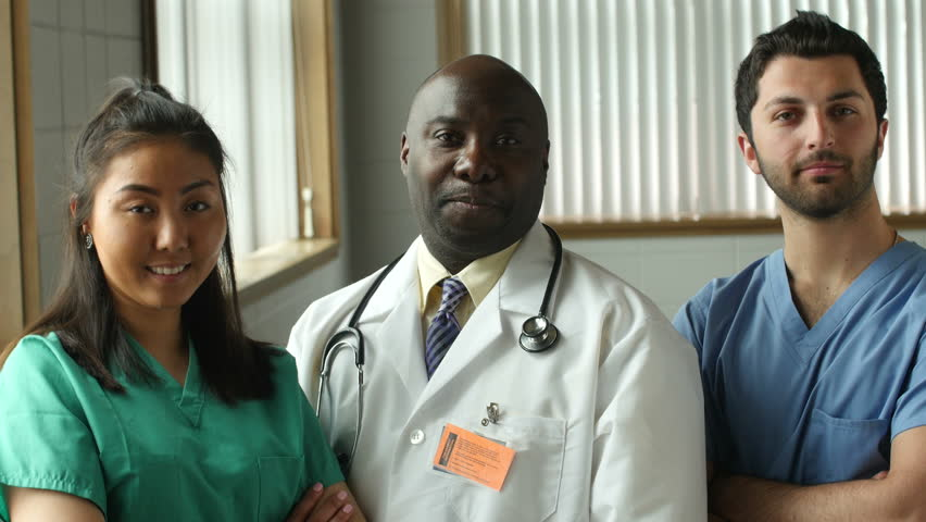 Confident and pleased medical team looks at the camera
