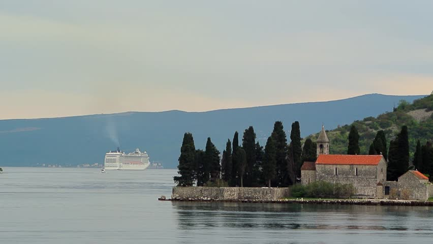 Island of Sveti Djordje in the Bay of Kotor in Montenegro. Big cruise ship in the background | Shutterstock HD Video #9765209