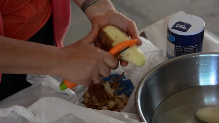 cleaning and slicing potatoes